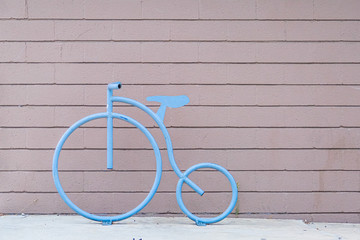 Steel Blue Bicycle Design on Plank Wall