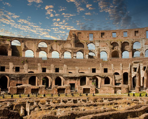 The walls and arches of the ancient coliseum in Rome, Italy