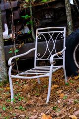 Old White Metal Chair in a Junkyard