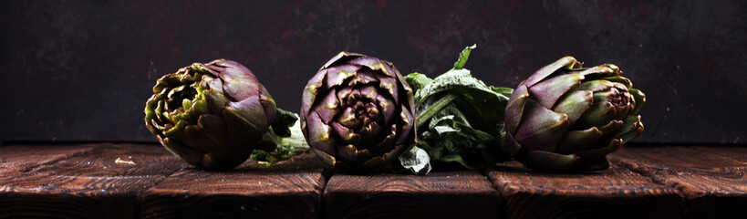 artichokes on rustic background. fresh raw organic artichoke flower. Fotobehang