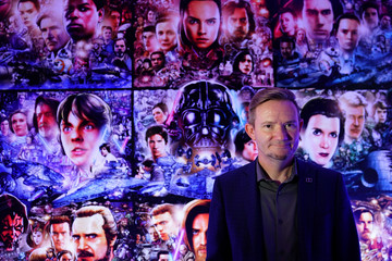 "Stuart Bowling, Content and Creative Relations Director Dolby Laboratories poses for a photo at an exhibit for ""Star Wars: The Rise of Skywalker"" at the Dolby store in the Manhattan borough of New York City"