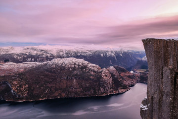 The famous Preikestolen Pulpit Rock over the Lysefjord, beautiful colors at sunset, Ryfylke, Rogaland, Norway
