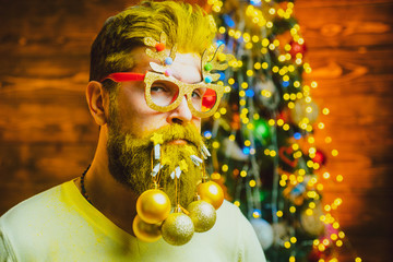 Merry Christmas and happy New Year. Hipster Santa at home. Happy new year. Bearded man in Christmas...