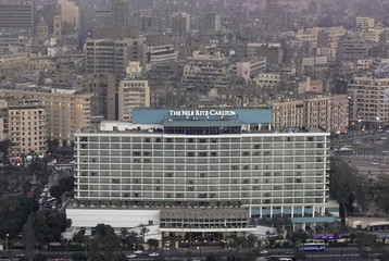 A view of The Nile Ritz-Carlton hotel is seen front of houses and buildings from Cairo tower in the capital of Cairo