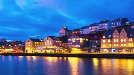 Wall Mural - Kristiansund, Norway. View of city center of Kristiansund, Norway during the cloudy night with colorful sky. Time-lapse of port with historical buildings