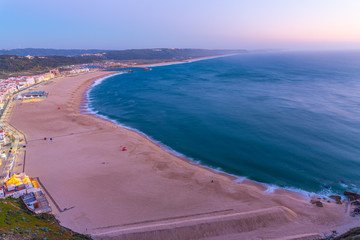 Wall Murals United States Sunset aerial view of a beach in Nazare in Portugal