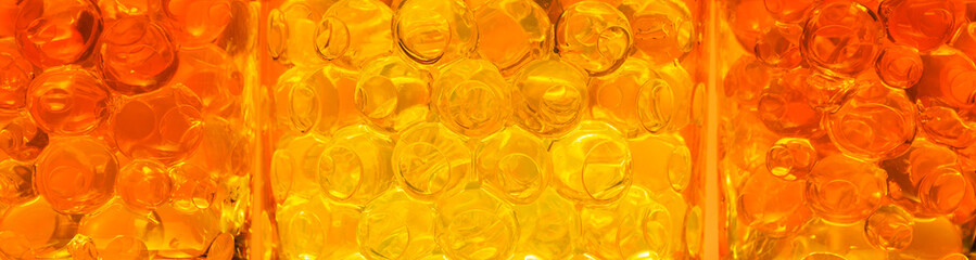 Abstract background with yellow and orange bubbles for design