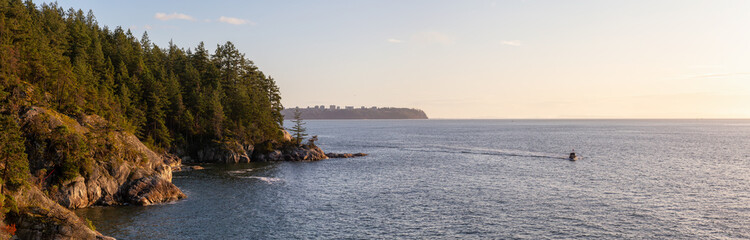 Wall Mural - Panoramic View of Rocky Coast in Lighthouse Park, West Vancouver, British Columbia, Canada, with UBC in background. Taken during a cloudy sunset.