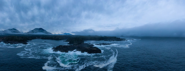 Ucluelet, Vancouver Island, British Columbia, Canada. Aerial Panoramic View of a Small Town near Tofino on a Rocky Pacific Ocean Coast during a cloudy sunrise.