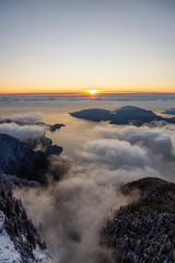 St Mark's Summit, in Howe Sound, North of Vancouver, British Columbia, Canada. Canadian Mountain Landscape View from the Peak during cloudy winter sunset.