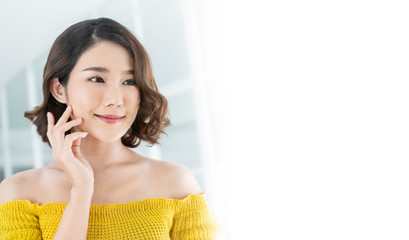 Portrait of beauty  smiling asian woman applying a lotion to her arm skin during her morning routine. Cute asian girl. Skincare body lotion, beauty clinic skincare spa, woman lifestyle concept banner