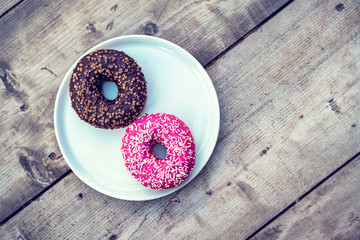 A plate of delicious donuts on a table