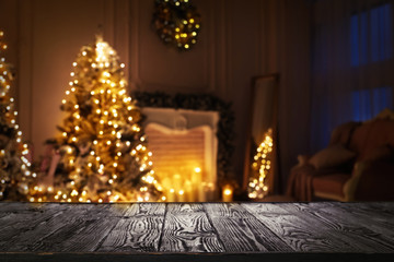 Fotobehang - Empty wooden surface and blurred view of room decorated for Christmas