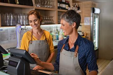 Mature women waitress working at coffee shop