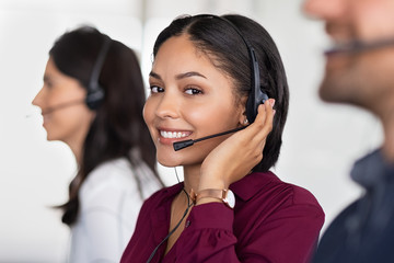 Young latin woman in customer service center