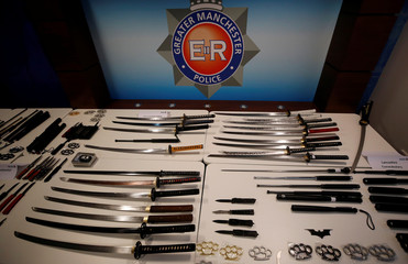 A selection of knives and weapons seized by police forces across the North West of England are seen on display during a press briefing at Greater Manchester Police headquarters in Manchester, Britain
