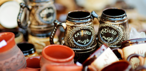 Ceramic dishes, tableware and jugs sold on Easter market in Vilnius, Lithuania