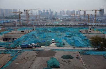 Construction sites are seen next to Zhengzhou East Railway Station in Zhengzhou