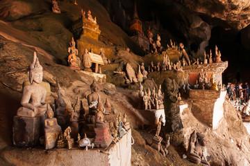 Myriad ancient Buddha statues in Pak Ou Caves.
