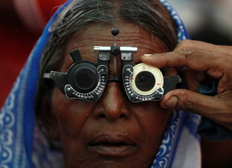 A woman gets her eyes tested at a free eye-care camp on the occasion of Indian politician Babasaheb Ambedkar's death anniversary in Mumbai