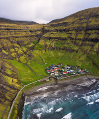 Wall Mural - Aerial view of the Tjornuvik village and its beach in the Faroe Islands
