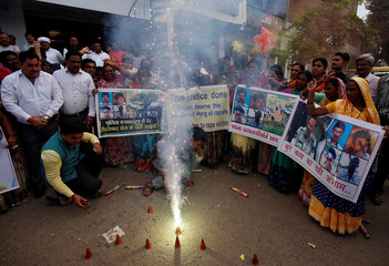 People light fireworks as they celebrate after police shot dead four men suspected of raping and killing a 27-year-old veterinarian in Telangana, in a residential area in Ahmedabad