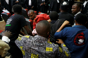 A fighting breaks out as security personnel attempt to re-arrest Nigerian activist Omoyele Sowore at the Federal High Court in Abuja