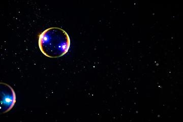 Multicolored soap bubbles on a dark background