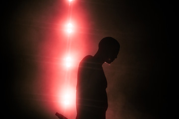 silhouette of man on black background