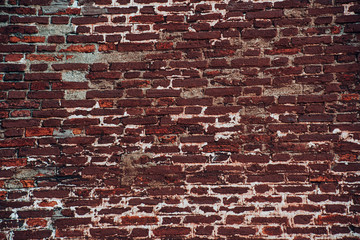 Red vintage brick wall with wreck surface