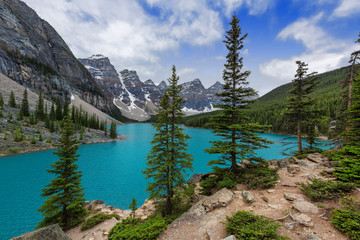 Moraine lake in Canadian Rockies and dramatic clouds, Banff National Park, Canada
