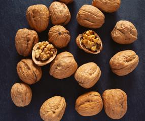 walnuts on black stone surface