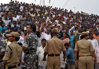 People shout slogans as they gather at the site where police shot dead four men suspected of raping and killing a 27-year-old veterinarian, in Chatanpally on the outskirts of Shadnagar town