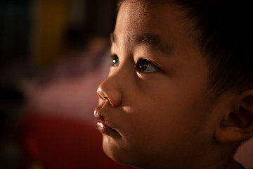 close up head shot of asian children looking with concentrate