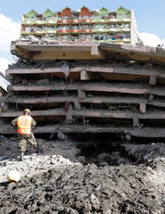 Rescue teams search the scene where a building collapsed in Nairobi