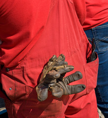 Poster Volcano Working gloves with overall. Worker. Shipyard