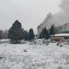 A burning building is seen in Presov, Slovakia