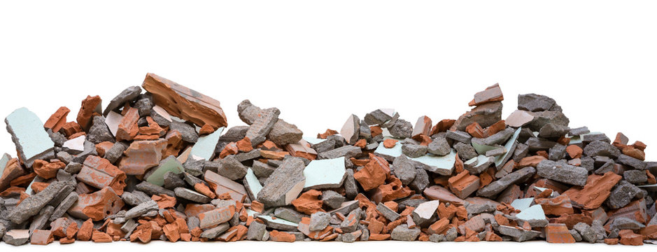 Pieces of concrete and brick rubble debris on building in civil war isolated on white background