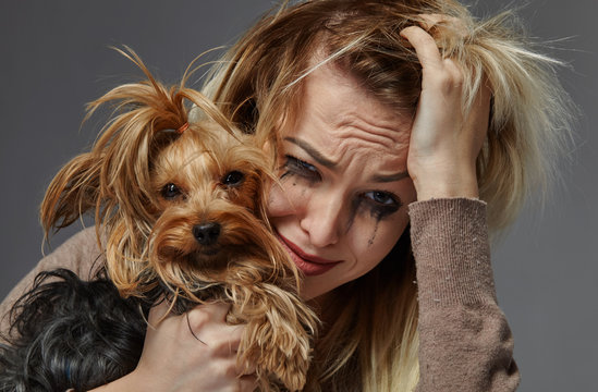 Woman with dog suffering from stress