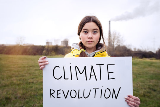 Teenager girl holding placard during global strike for climate change