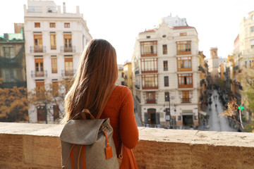 Travel in Spain. Back view of young traveler woman enjoying cityscape of Valencia, Spain, Europe.