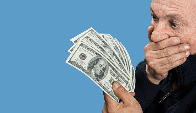 old man holding dollar bills