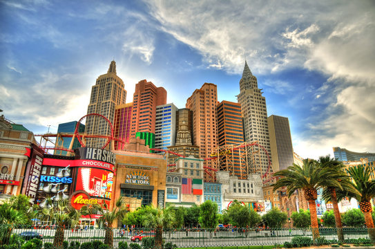 LAS VEGAS, NEVADA, MAY 16: Artistic colorful HDR image of sunset behind the New York-New York Casino and Hotel with its roller coaster. Las Vegas, May 16, 2016