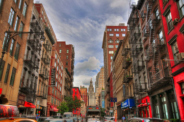 NEW YORK CITY, AUG 7: Colorful HDR image of a typical New Yorker street Manhattan. NYC, USA August 7, 2017