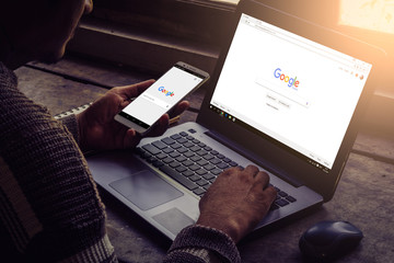 Bangkok. Thailand. June 9, 2017 : Man is typing on Google search engine from a laptop. Google is the biggest Internet search engine in the world.