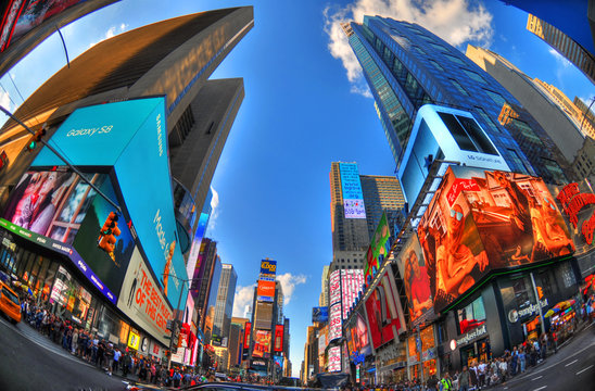 NEW YORK CITY, AUG 7: Colorful HDR fisheye the famous Times Square in Manhattan. NYC, USA August 7, 2017