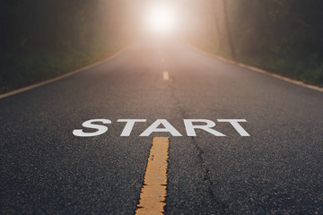 Conceptual image with word start on asphalt road .Start Your Life Wall mural