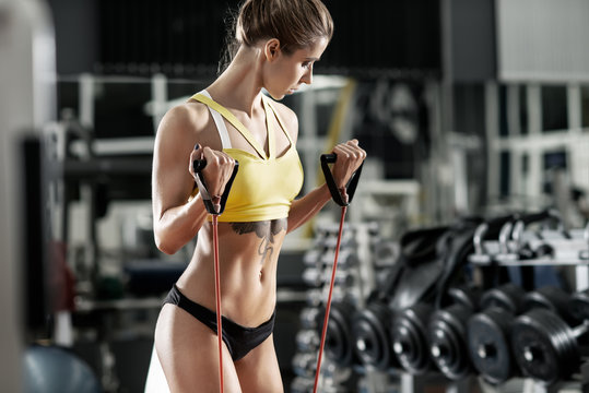 beautiful woman bodybuilder in GYM