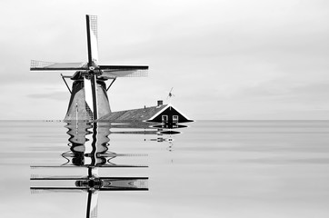 The beginning of the end, climate change does not exist, phrase of D.Trump, climate change, Artistic black and white photograph of Famous places in Amsterdam, Holland, flooded by the rising sea,
