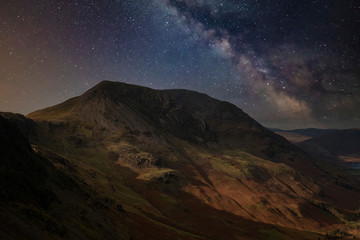 Spoed Foto op Canvas Chocoladebruin Stunning majestic digital composite landscape of Milky Way over Haystacks and High Stile in Lake District